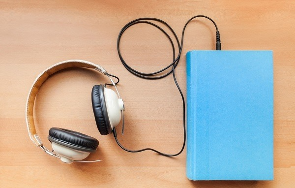 A blue book plugged in to headphones.